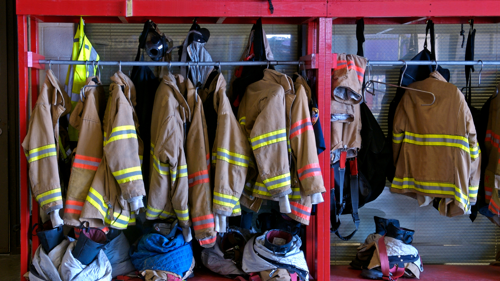 Firefighters jackets hanging in firehouse