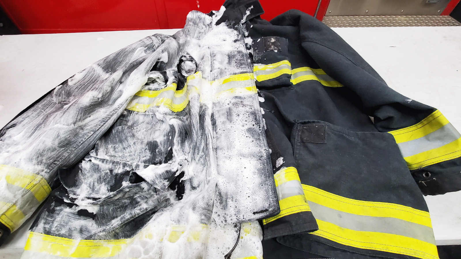 Firefighters jacket being cleaned by Redline Gear Cleaning